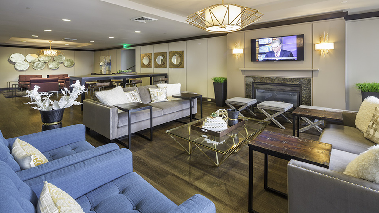 Resident lounge with access to TV and flexible work space