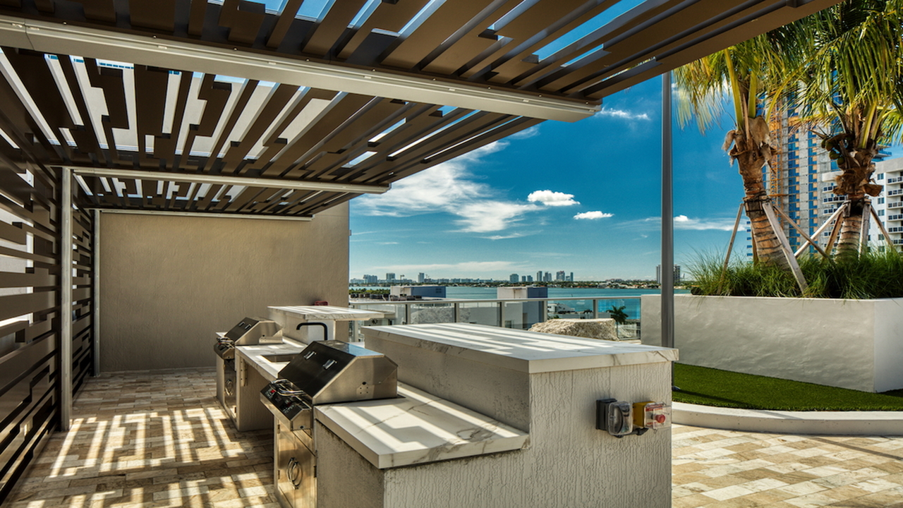 Rooftop Deck with Grill Stations | Modera Edgewater | Apartment Homes | Miami, Florida