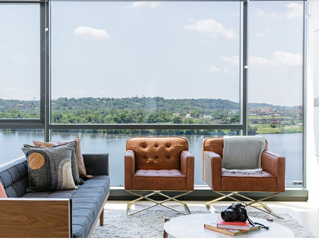 Floor to Ceiling Windows in the Living Room Overlooking Lush Landscape and the Water