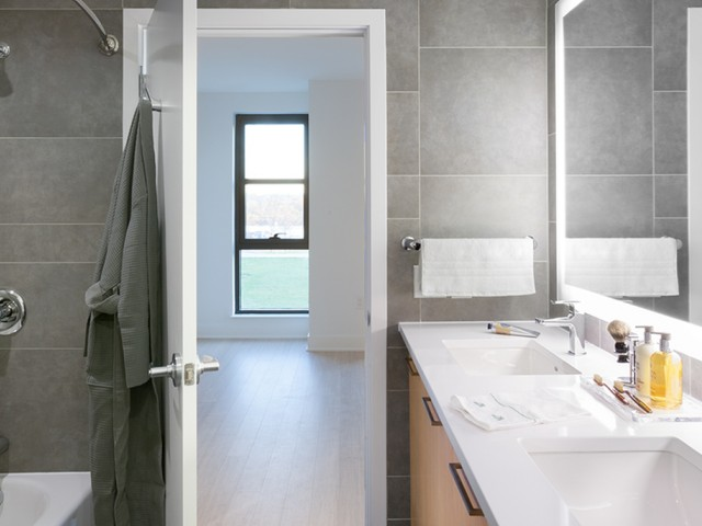 Image of Luxurious bathrooms with double sinks and a full length mirror for Arris
