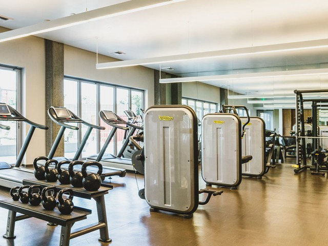 Blossom Plaza | Expansive fitness center with state of the art equipment