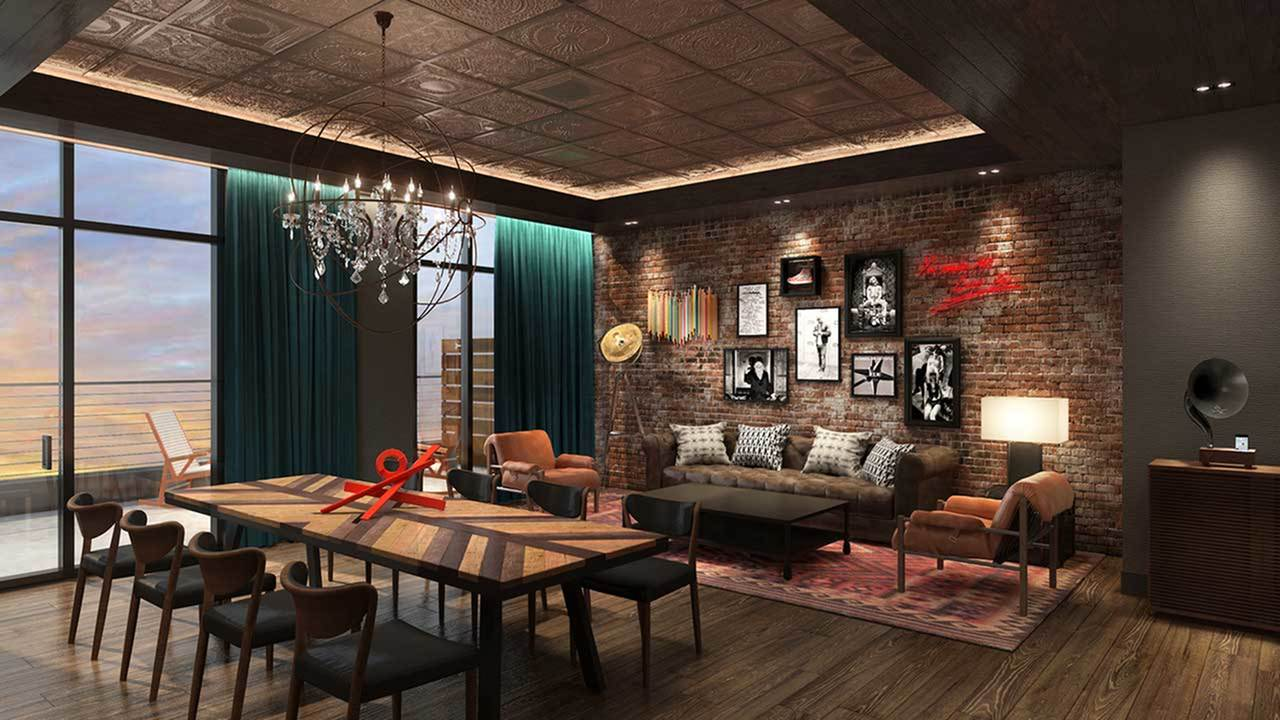 Interior of upscale resident lounge with brick wall feature and floor to ceiling windows