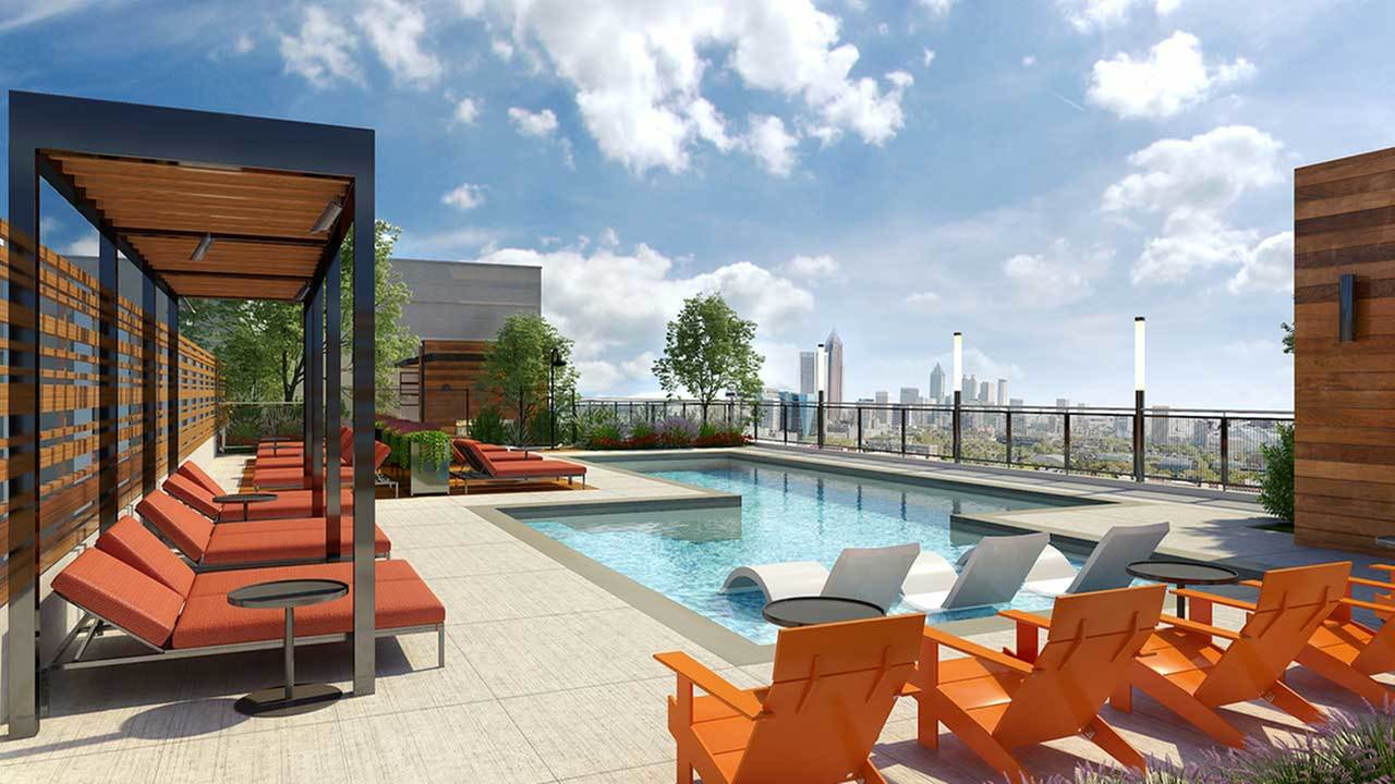 Roof top pool area with covered lounge seating