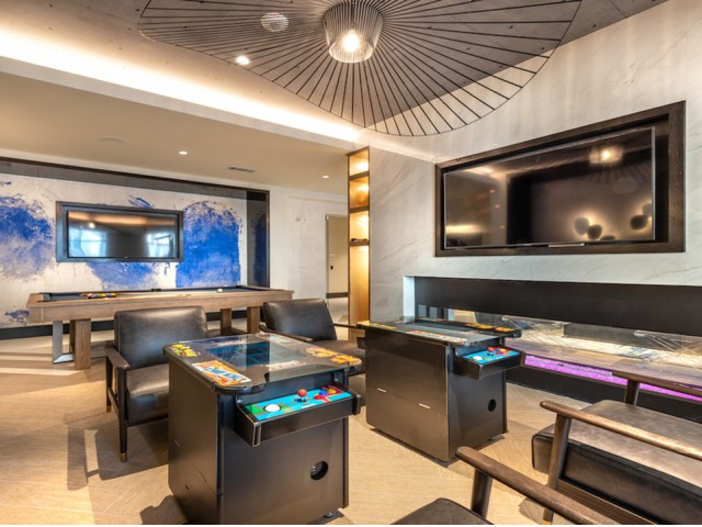 Photo of game stations and clubhouse with TV\'s, tables and chairs