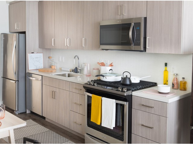 chef-inspired kitchens with stainless steel appliances, custom cabinetry and quartz countertops