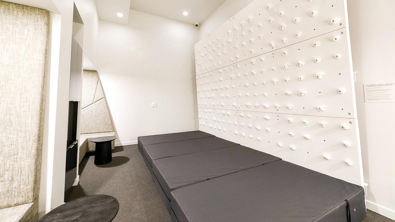 white indoor rock climbing wall