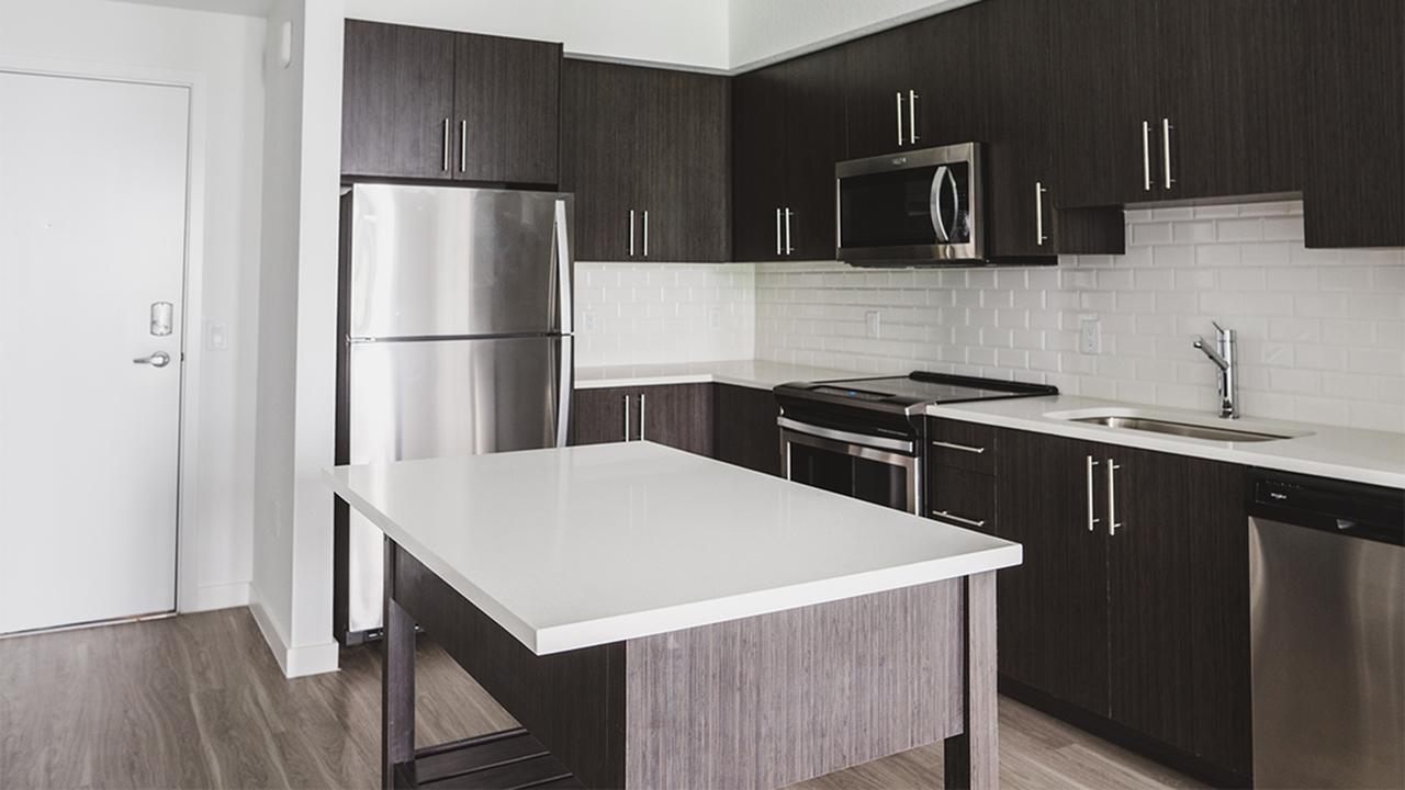 Custom espresso cabinetry, tile backsplash, kitchen islands, and so much more!