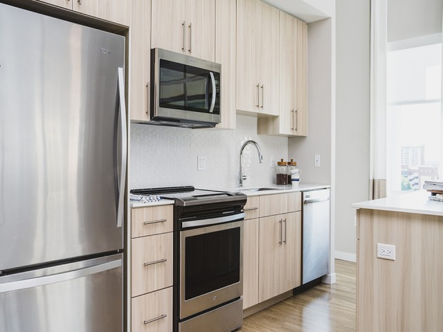 Stunning kitchens with stainless steel appliance package and custom cabinetry
