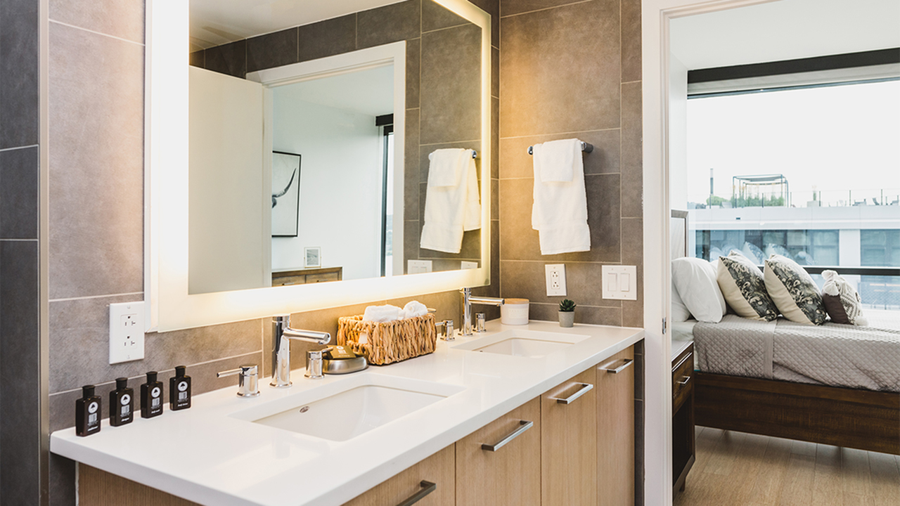 Luxury bathroom with white quartz counter and double sinks