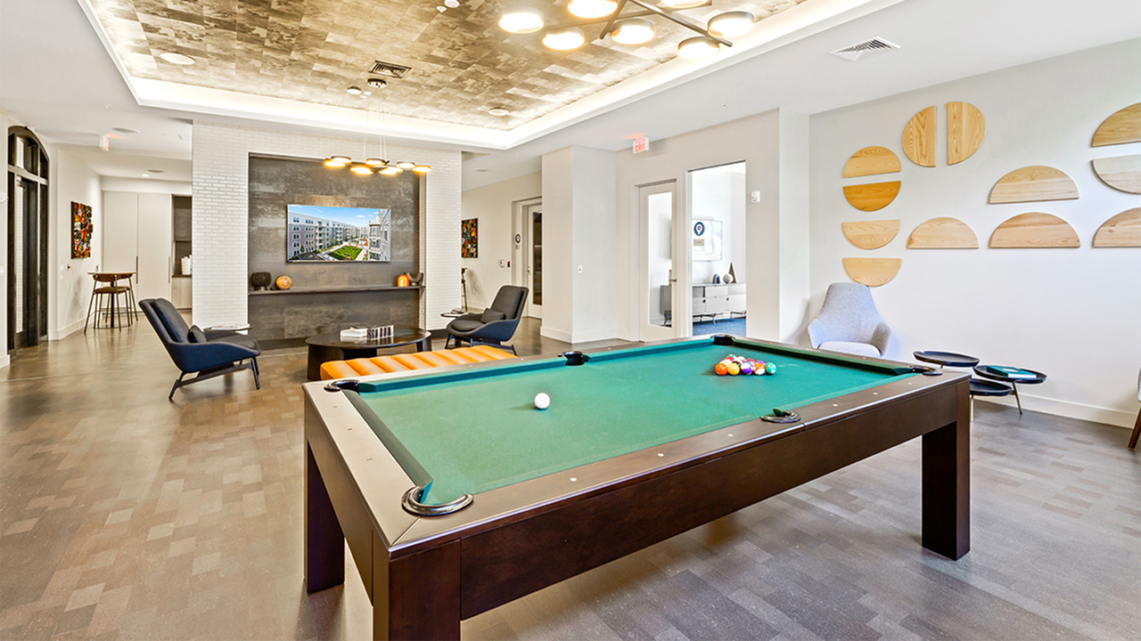Billiards table with TV and lounge areas