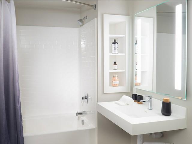 Bathrooms with tile backsplash and built in storage