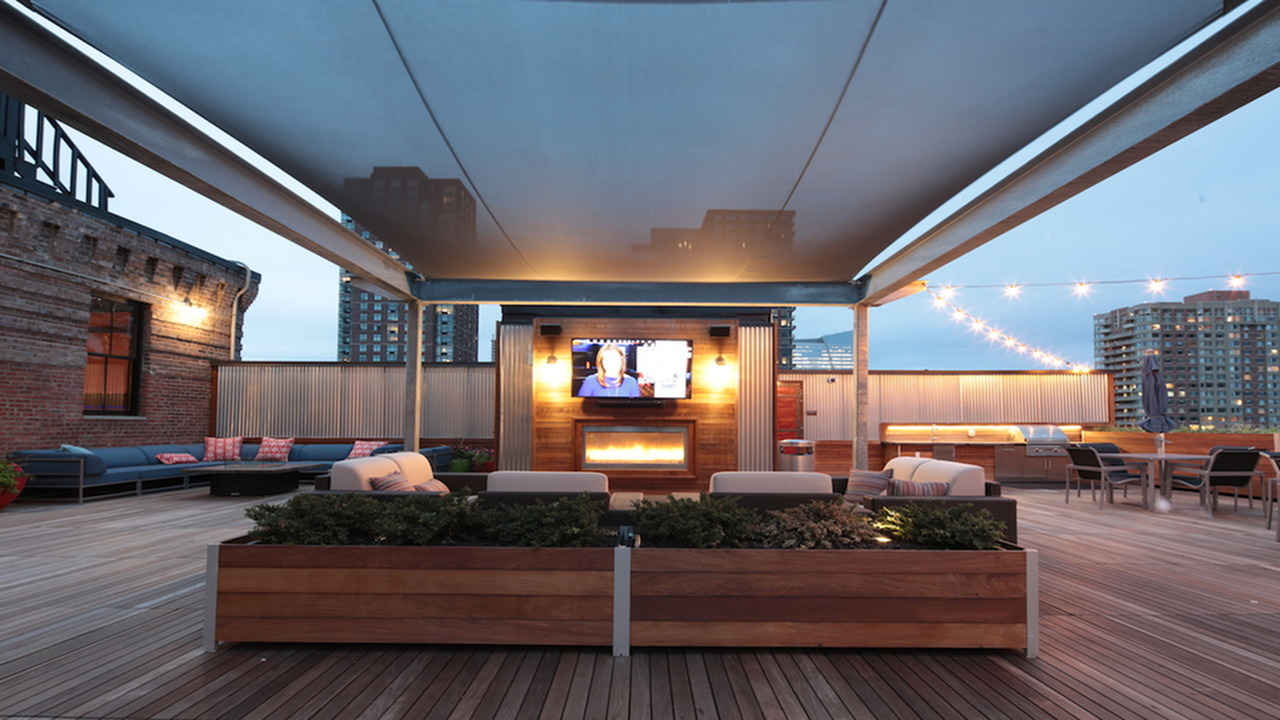 Roof Top Deck with Entertainment Seating around a Wall Mounted Television