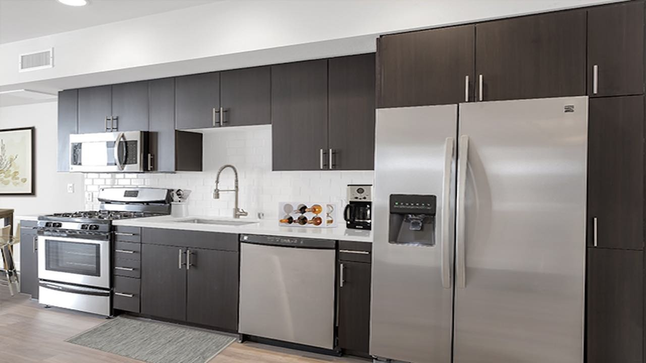 Kitchen with Espresso Cabinetry and Stainless Steel Appliances