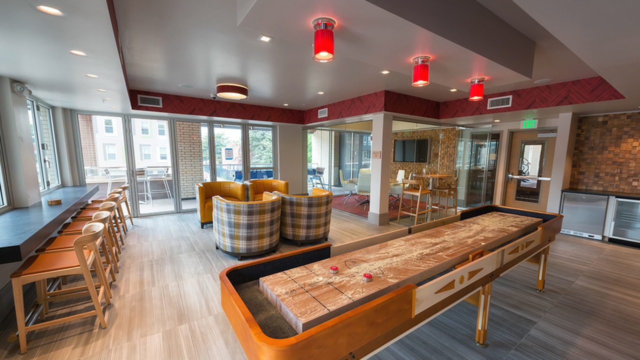 Shuffleboard and Social Seating in our Party Pod