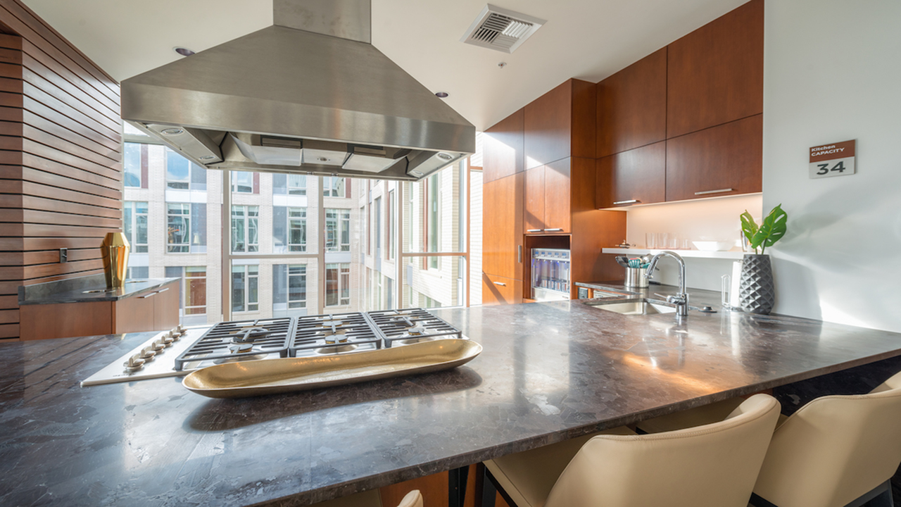 Demonstration kitchen with gas cooktop in the resident lounge