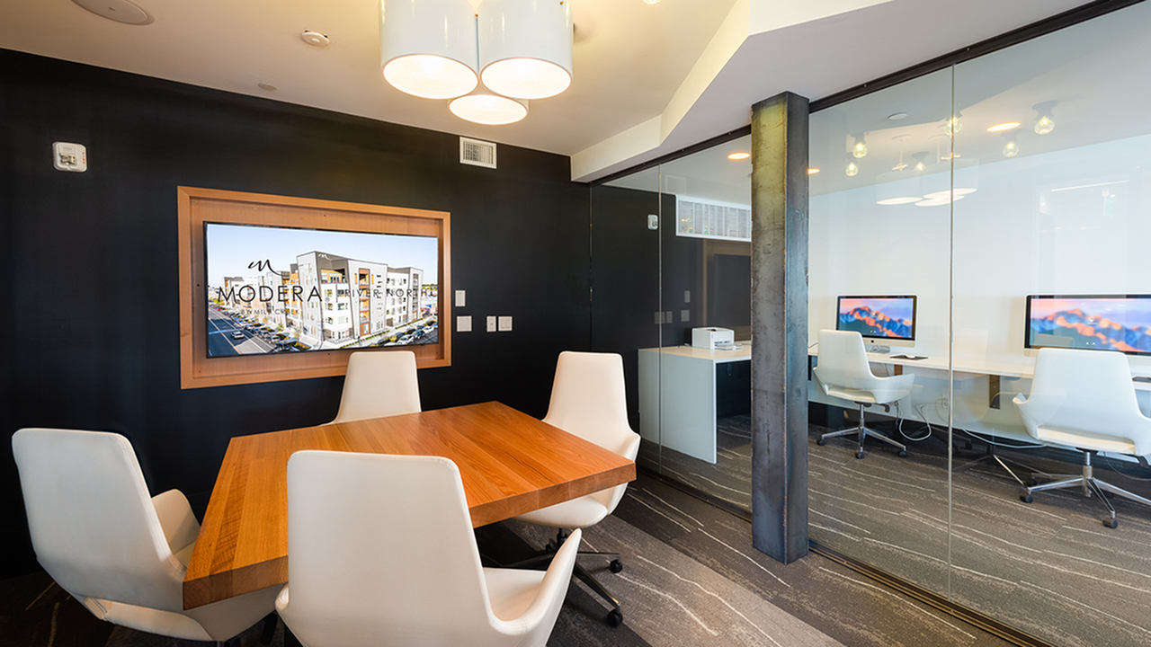 Intimate resident conference center with floor to ceiling windows near business center
