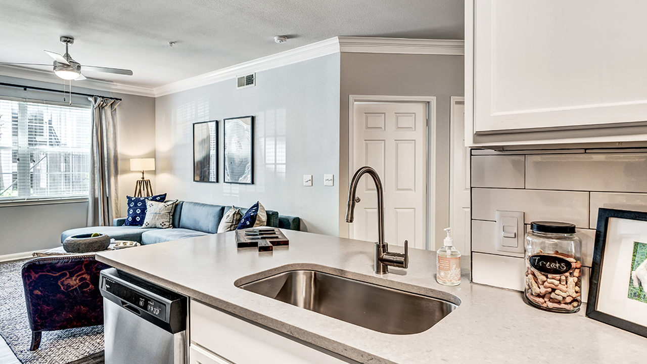 Farmhouse sink in kitchen of model home