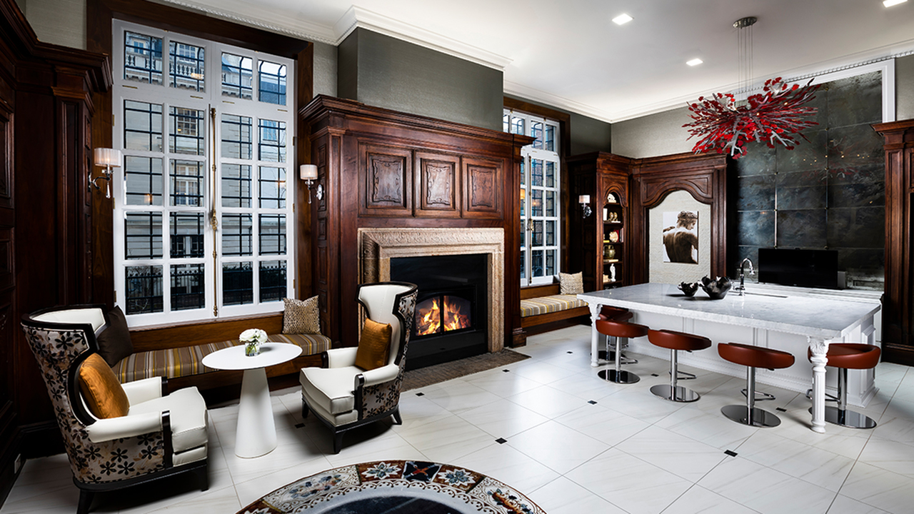 Preserved Historical Elements and Cabinetry in Grand Lounge area featuring a Fireplace