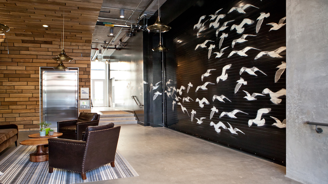 Customer lounge with feature wall of flying birds