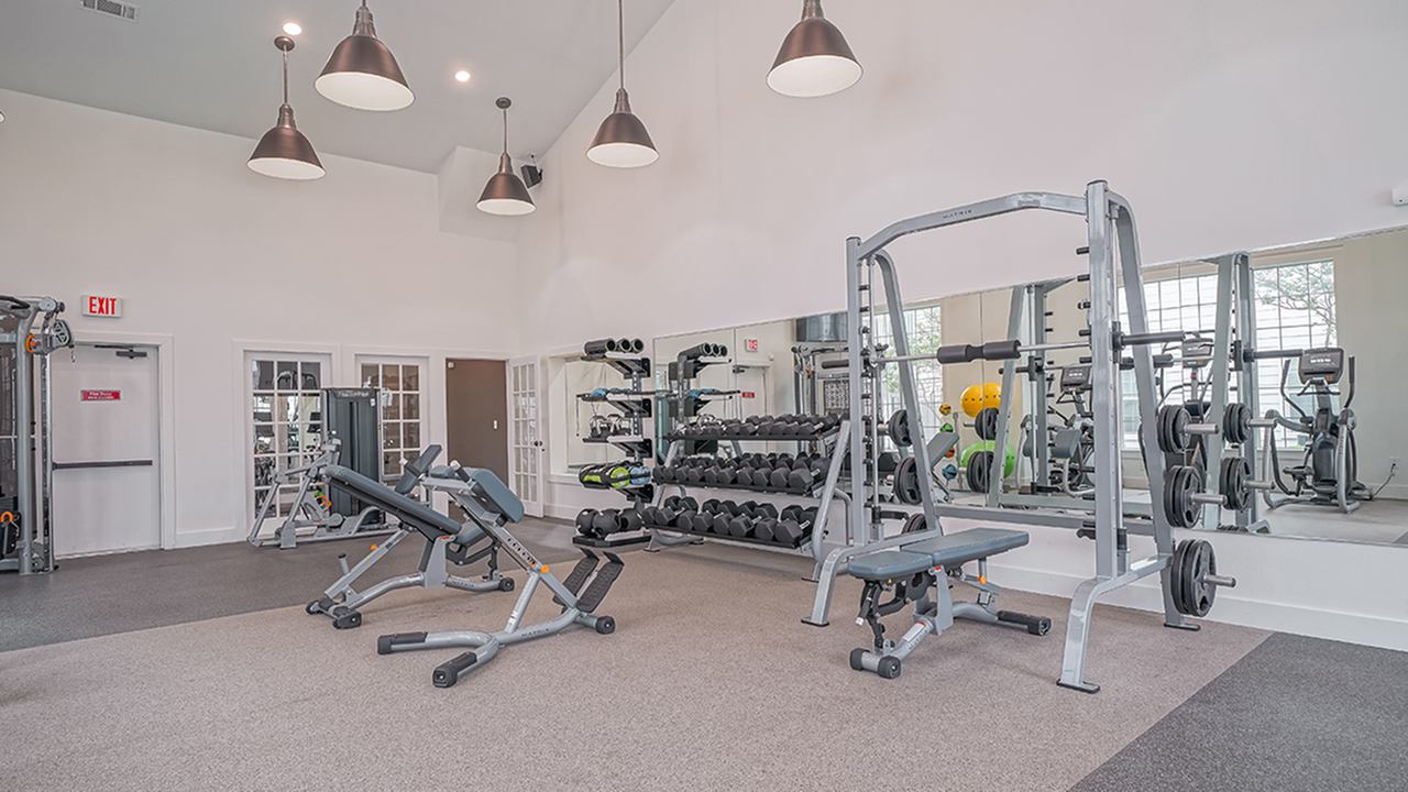 Fitness center with free weights and benches