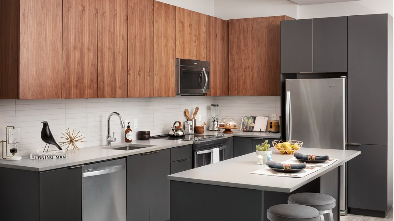 Open concept kitchen with stainless steel appliance package