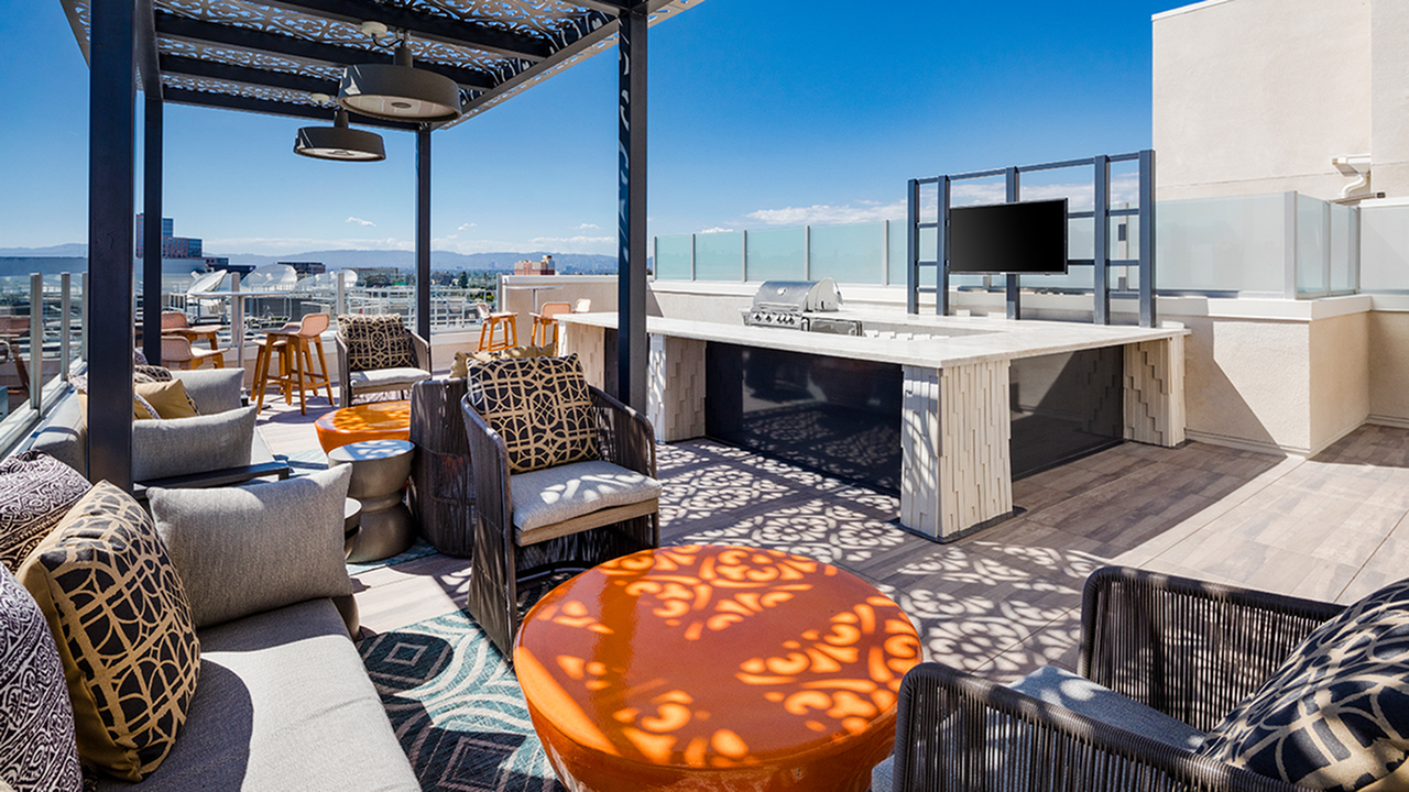 Spacious outdoor amenity space with cozy seating and a gorgeous view