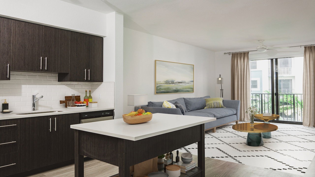 Living and dining area with private balcony showcasing brown cabinetry and a island with storage