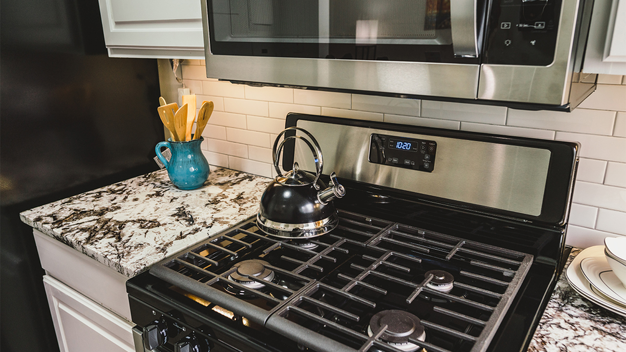 New gas range and microwave in upgraded homes