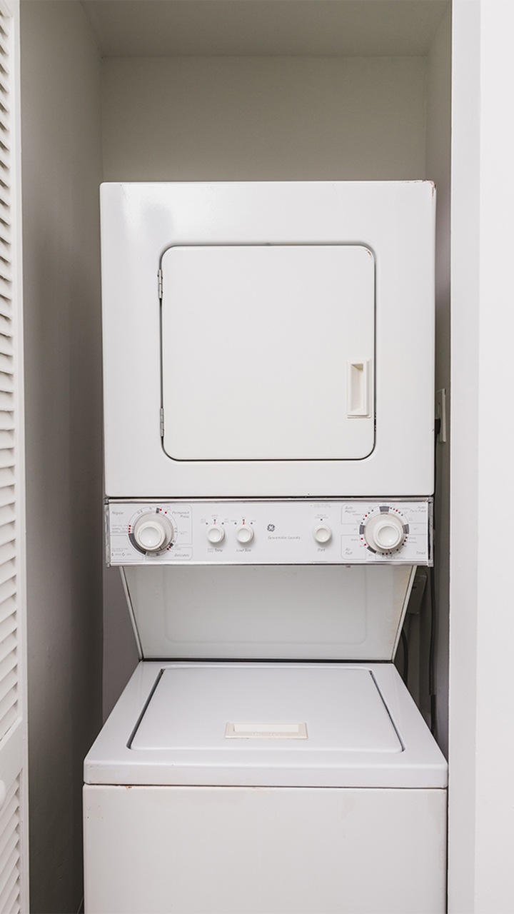 Stackable washer and dryer in closet.