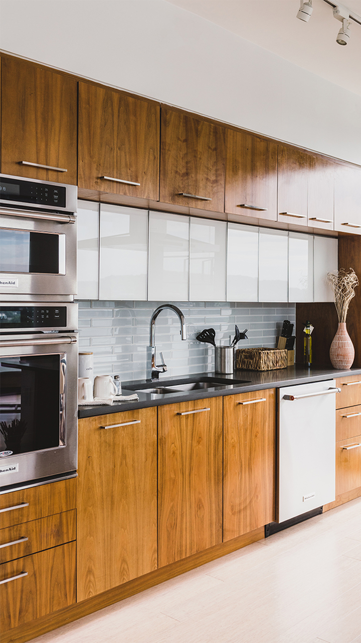 Two tone white and brown cabinets in Arris apartment kitchen