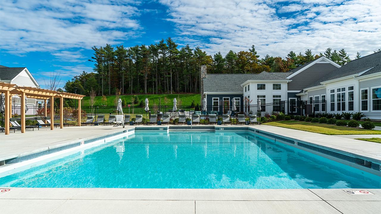 Lavish pool with sundeck and lounge seating