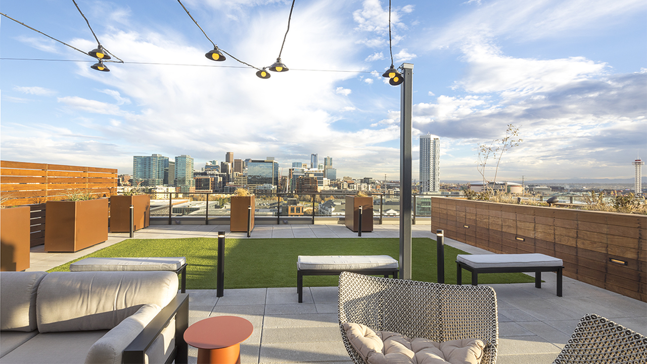 Modera LoHi pool deck with views of downtown, nearby restaurants and retail