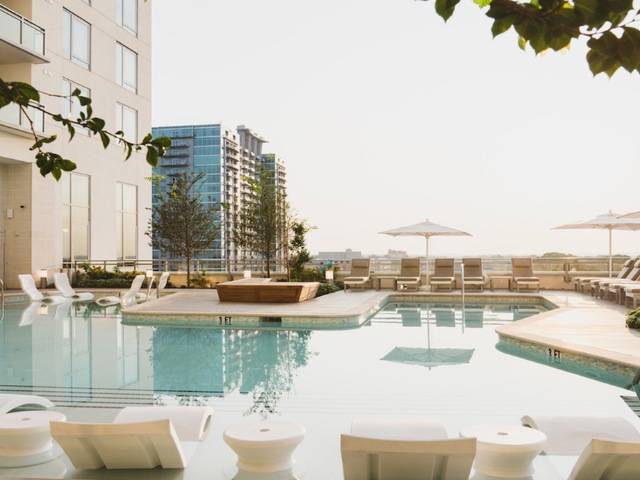 Pool with chaise lounge seating and downtown Atlanta views