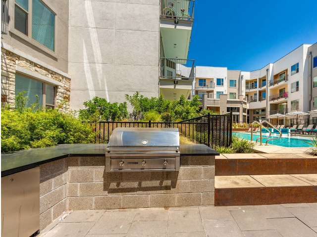 Outdoor grilling area near pool
