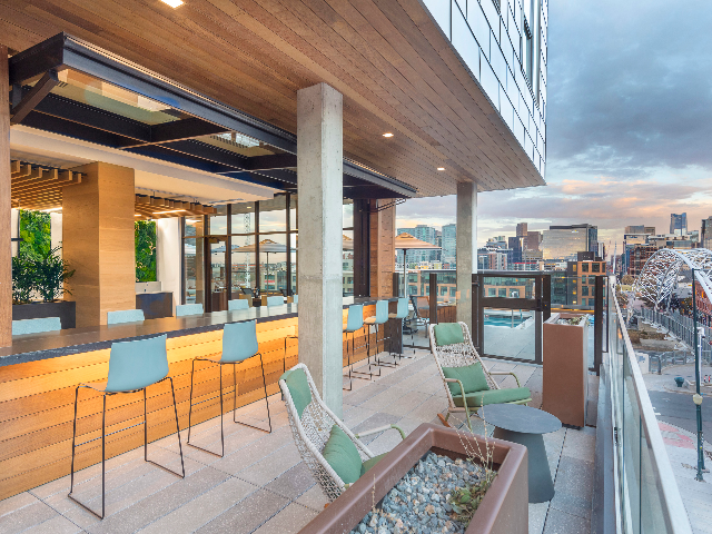 Indoor and outdoor terrace with mountain and city views