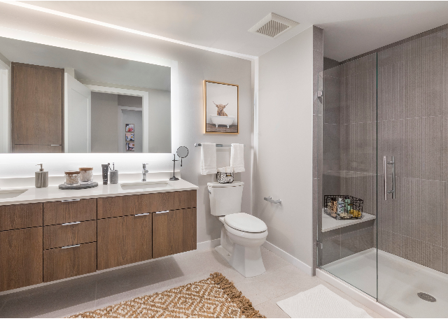 Showers with built-in quartz benches and frameless glass doors