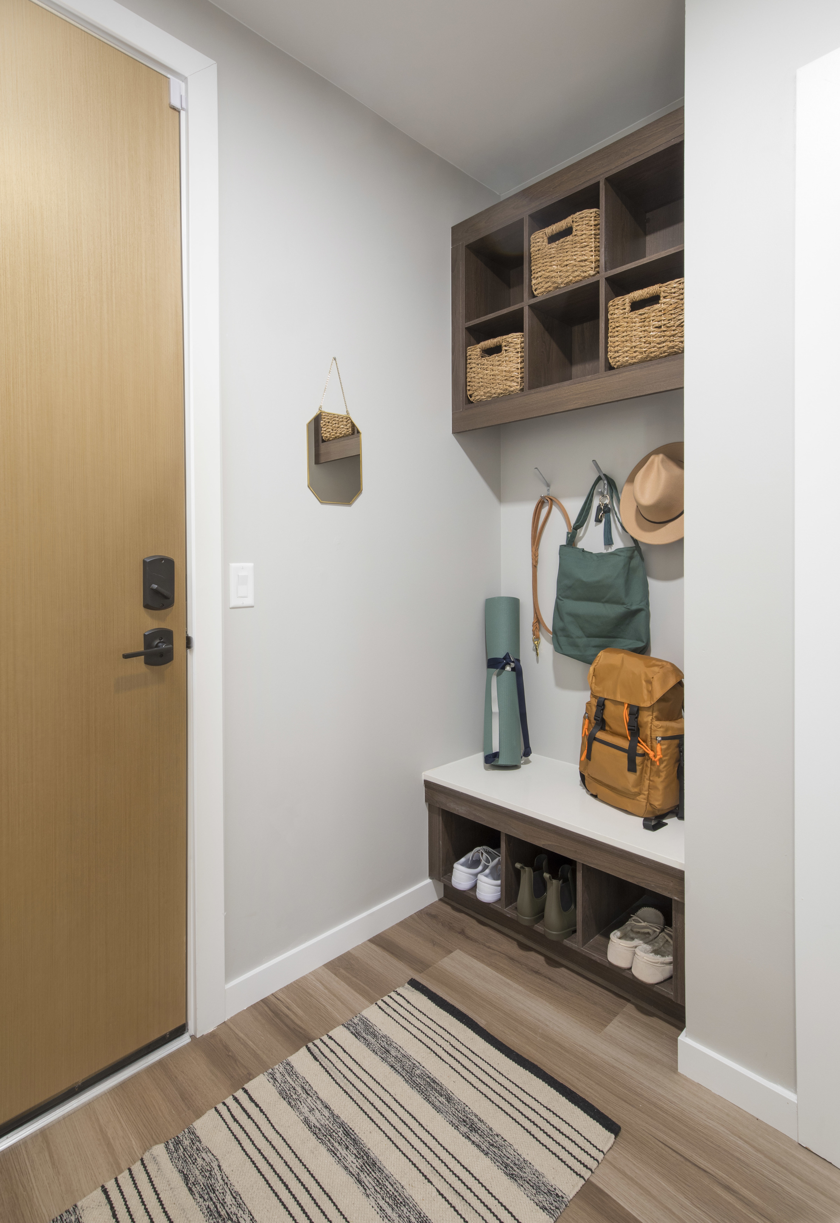 Built-in mudrooms with cubbies for storage and key drops