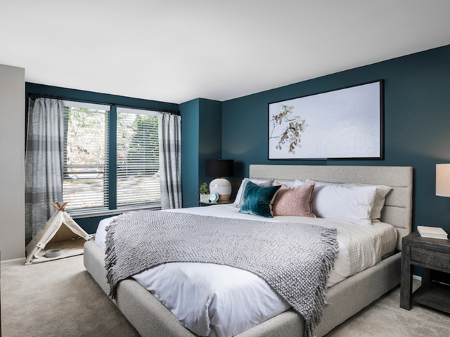 King sized bedroom with furniture