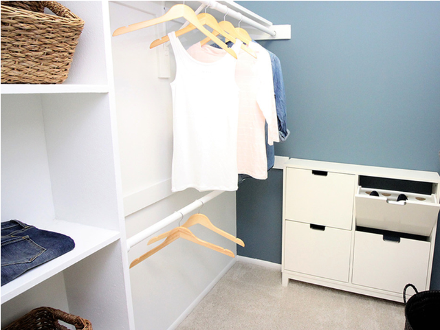 Walk in closet with custom cabinetry