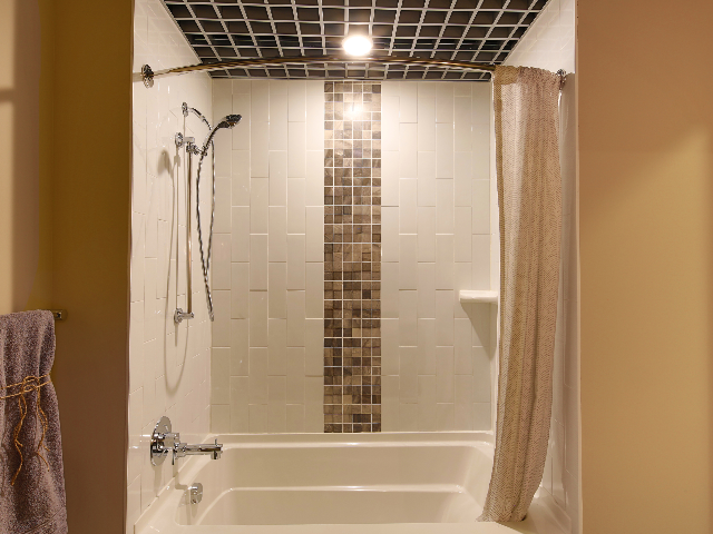 Soaking tub with decorative tile surround