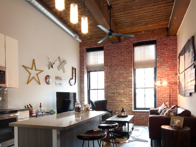 Furnished home with exposed brick work