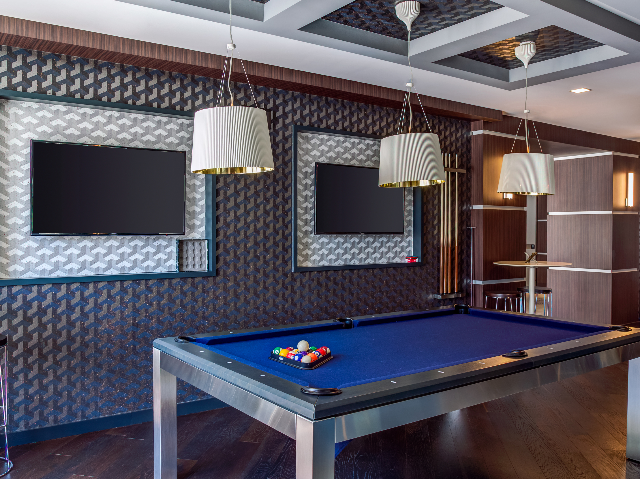 Alister Deco Modern glass-walled club room with pool table and fireplace