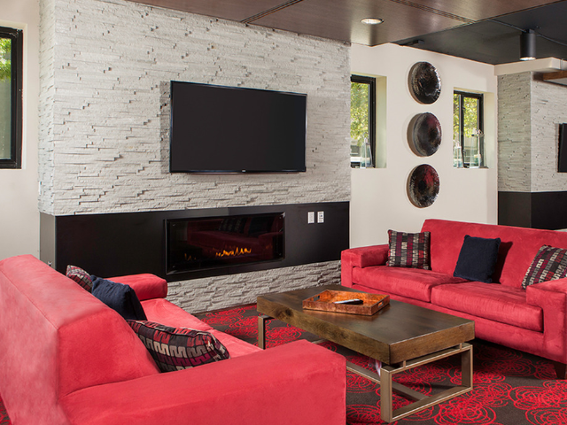 Seating area in clubroom near gas fireplace