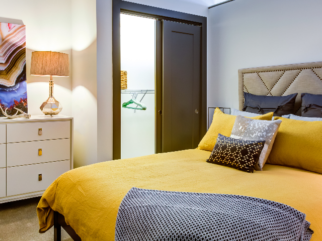 Furnished bedroom featuring walk in closet