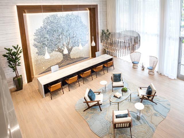 Wifi access available in amenity areas, like this two-story lobby with large seating area