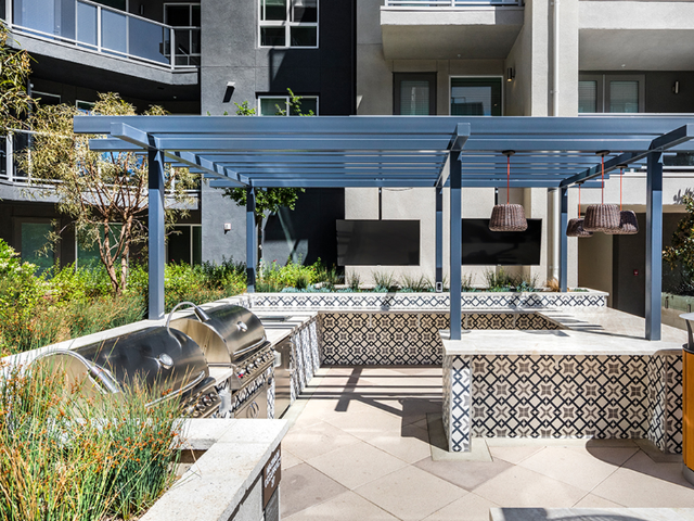 Grilling stations and a terrace with outdoor bar seating