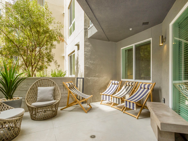 Outdoor private balcony with seating