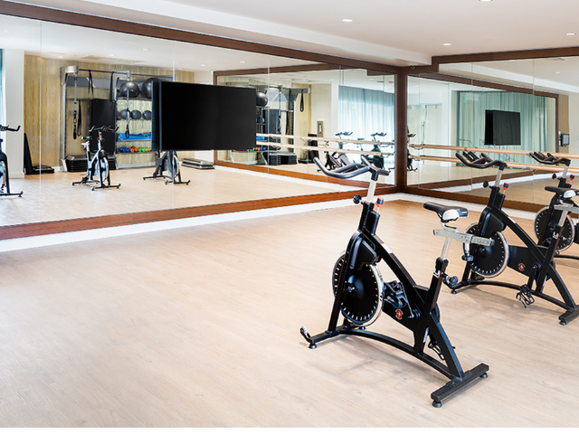 Wellbeats virtual fitness training technology available in group fitness area