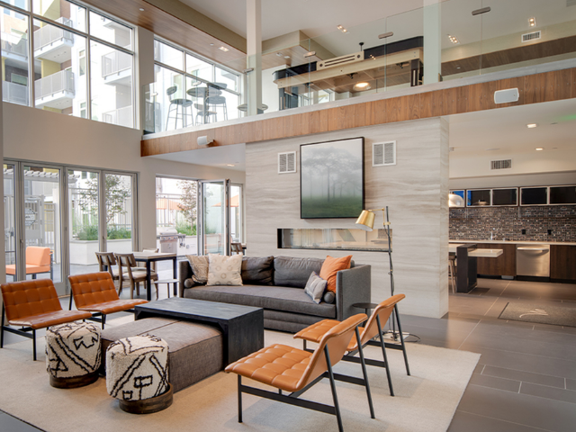 Two story resident lounge with demonstration kitchen