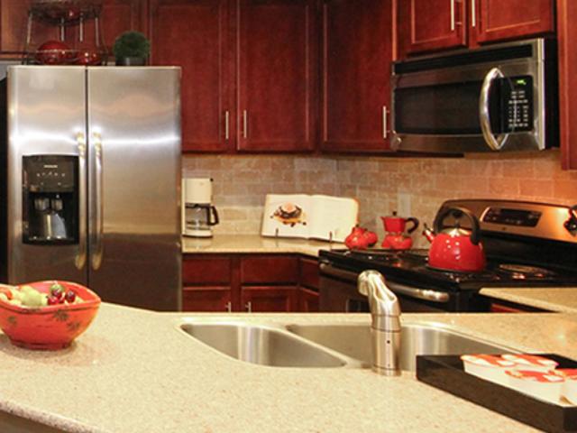 Kitchen with silestone quartz countertops and tile backsplash